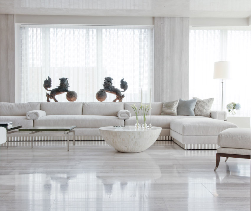 Living room features travertine floor and walls, a waxed Venetian-plaster ceiling and custom-made sofa.
