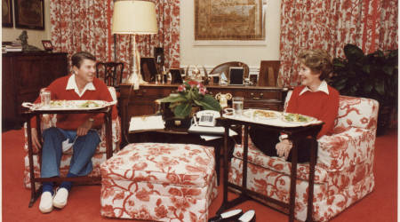 The Reagans dining off of TV trays in the White House, 1981
